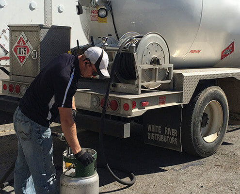 Onsite propane cylinder delivery and refill service